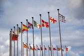 International flags against the sky — Stock Photo