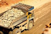 Huge trucks work in a quarry mining — Stock Photo