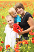 Beautiful woman with a childs in the spring  field — Stock Photo