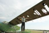 Boy on the wing vintage aircraft — Stock Photo
