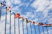 International flags against the sky — Foto de Stock