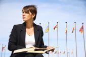 Mujer de negocios con un libro — Foto de Stock