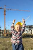 Little boy at a construction site in the form of working — Stock Photo