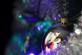 Santa Claus with gifts and funny boy in a New Years ball reflection — Stock Photo