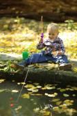 Funny boy  catches a fish — ストック写真