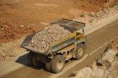 Huge trucks work in a quarry mining — Foto de Stock