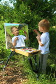 Funny kid draws a picture on the mirror — Stock Photo