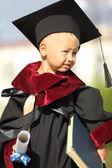 Graduate  on a background of international university — Stock Photo