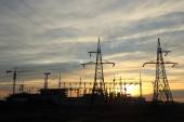 Silhouette of construction and power lines at sunset — Stock Photo