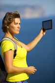Woman with tablet computer on the coast — Stock Photo