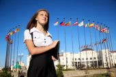 Girl student on the background of international flags — Stock Photo