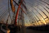 Sunset on the sea with an old sailing ship — Stock Photo