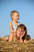 Family resting in a haystack — Stock Photo