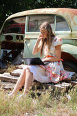 Country girl with a laptop — Stock Photo
