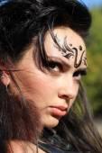 Beautiful girl aggressive warrior Amazons — Stock Photo