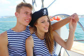 Couple in love pirates at the helm — Stock Photo