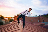 Young bold girl woman hipster jumping on the roof, dressed like — Stock Photo