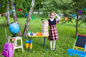 Schoolgirl child kid girl holding a huge pack of books with her  — Foto de Stock