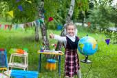 Happy schoolgirl child kid girl holding globe and smiling, thumb — Stockfoto