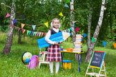 Happy schoolgirl child kid girl holding a huge big pencil, class — Stockfoto