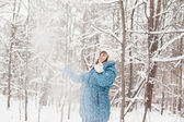 Pregnant woman in winter forest — Stock Photo