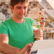 Young man on terrace with tablet and wine — Stock Photo #59638113
