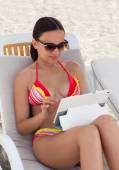 Young woman girl in sunglasses with tablet pc — Stock Photo
