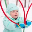 Cute baby boy playing in park in winter — Stock Photo #59876197