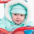 Cute baby boy playing in park in winter — Stock Photo #59876133