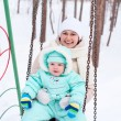 Happy family mother and baby in park in winter — Stock Photo #59876141