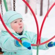 Cute baby boy playing in park in winter — Stock Photo #59876161