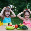 Happy children with vegetables — Stock Photo #69692863