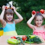 Two happy girls kids children wearing beautiful dresses holding — Stock Photo #69692865