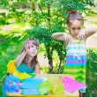Girls, sisters, kids, friends cutting multicolored paper outdoor — Stock Photo #69692991