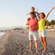 Happy family mum, dad and kid on the beach  — Stock Photo #70868669