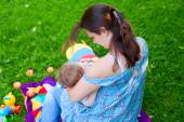 Mother woman breastfeeding baby boy kid — Stock Photo