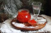 New Year's still-life, red caviar and wine-glass of vodka and fur-tree branch — Stock Photo
