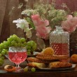 Still-life with pink wine and fruit, flat cakes and gladioluses — Stock Photo #61586343