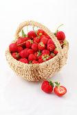 Fresh ripe strawberry in a wattled basket  — Stock Photo