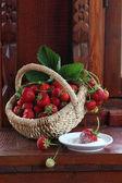 Fresh strawberry in a wattled basket — Stock Photo