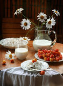 Fresh sweet cherry, cottage cheese and milk in a transparent jug — Stock Photo