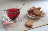 Fruit tea with puff cookies — Stok fotoğraf