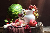 Wine, grapes, a pomegranate and a water-melon — Stock Photo