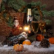 Champagne, tangerines, Bengal fire and fur-tree branch with cone — Stock Photo #62852635