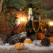 Champagne, tangerines, Bengal fire and fur-tree branch with cone — Stock Photo #62852663