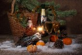 Champagne, tangerines, Bengal fire and fur-tree branch with cone — Stock Photo