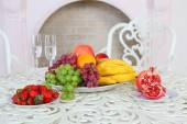 Grapes, bananas, a pomegranate, an orange and apples and a straw — Stock Photo