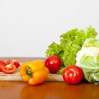 Still-life from fresh salad, a tomato, pepper and a cauliflower — Stockfoto #63368225
