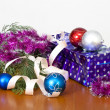 Tinsel, spheres for an ornament of a fur-tree and a gift package — Stock Photo #63368235