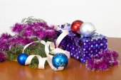 Tinsel, spheres for an ornament of a fur-tree and a gift package — Stock Photo